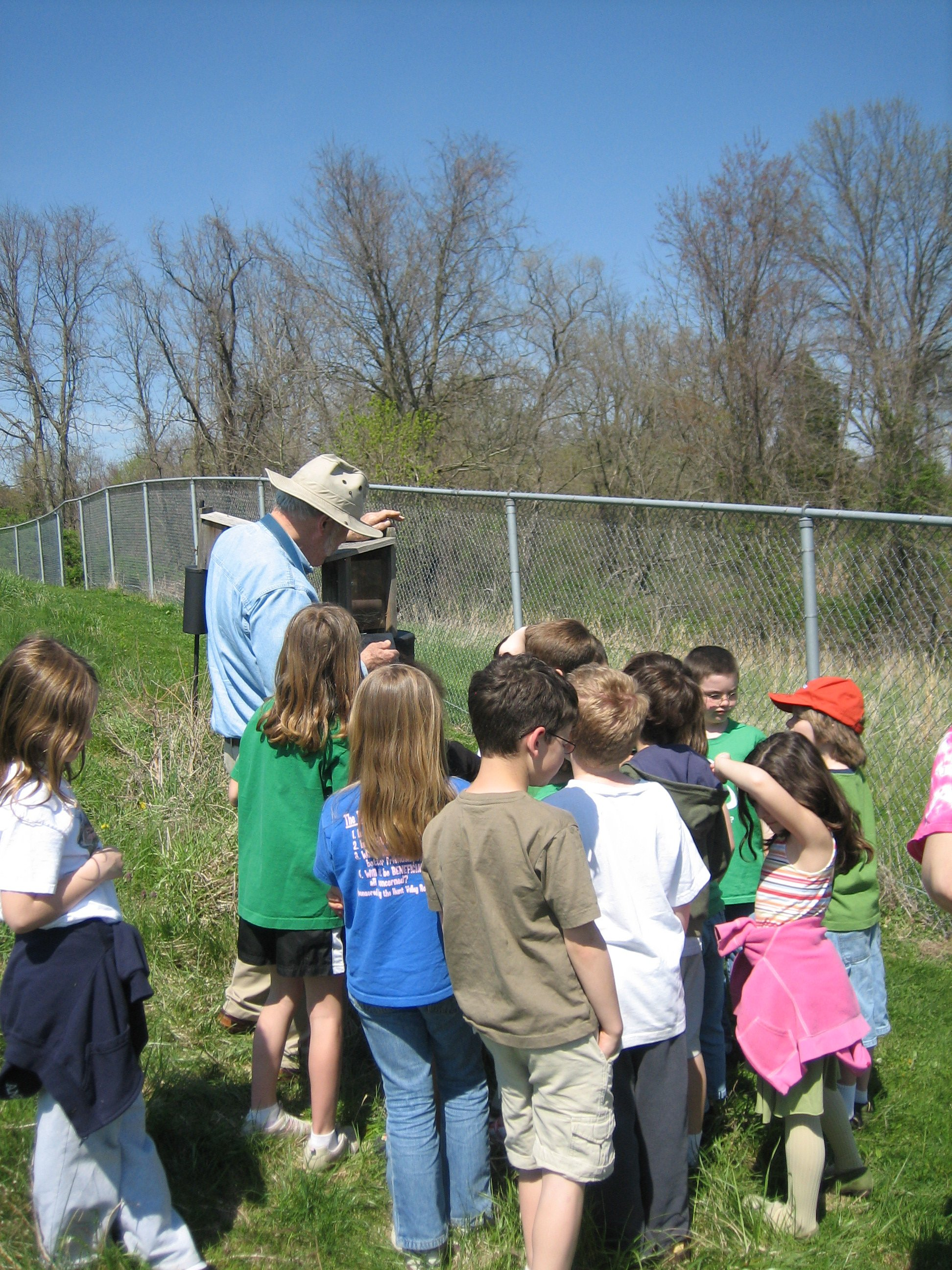 Students observe eggs in nest boxes along the blue bird trail